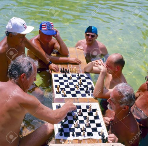 10592756-Men-playing-chess-in-the-Szechenyi-thermal-baths-spa-and-swimming-pool-in-Budapest-Hungary-Focused-a-Stock-Photo
