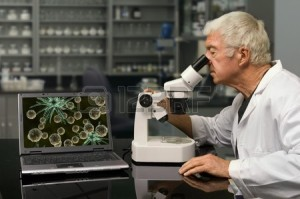 9501817-biologist-looking-through-a-microscope-in-a-research-lab